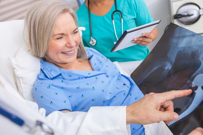 Patient in hospital bed following hip replacement