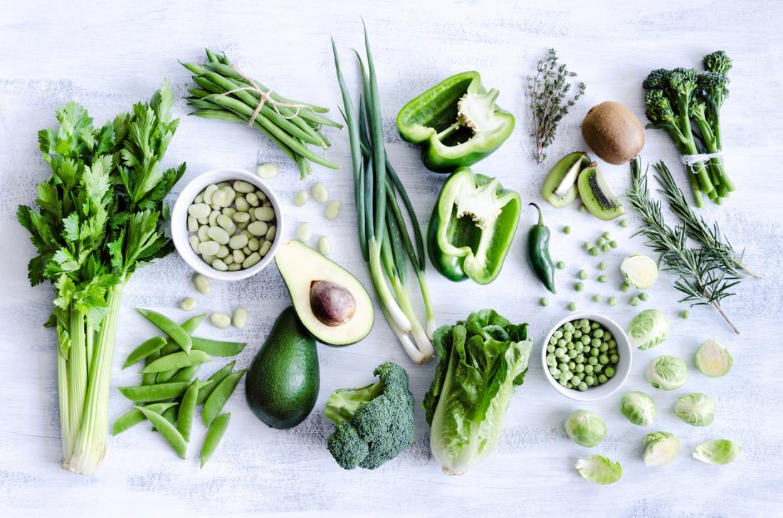 A selection of leafy green vegetables and fruits.