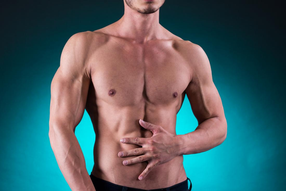 muscular man holding his stomach