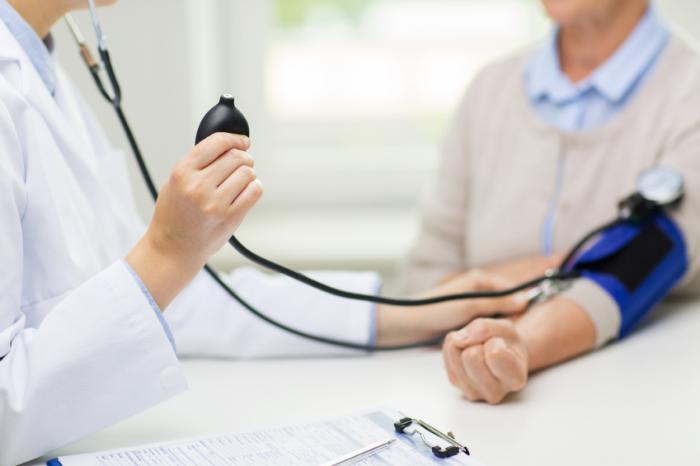 a doctor measuring blood pressure of older adults