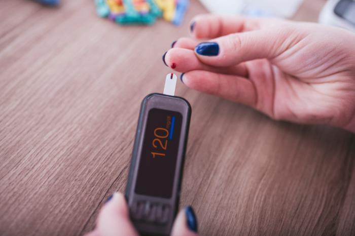 woman takes blood sugar test