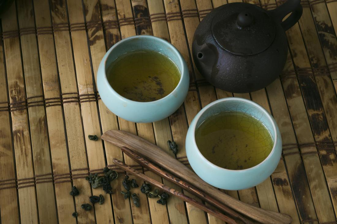 pot and cups of green tea