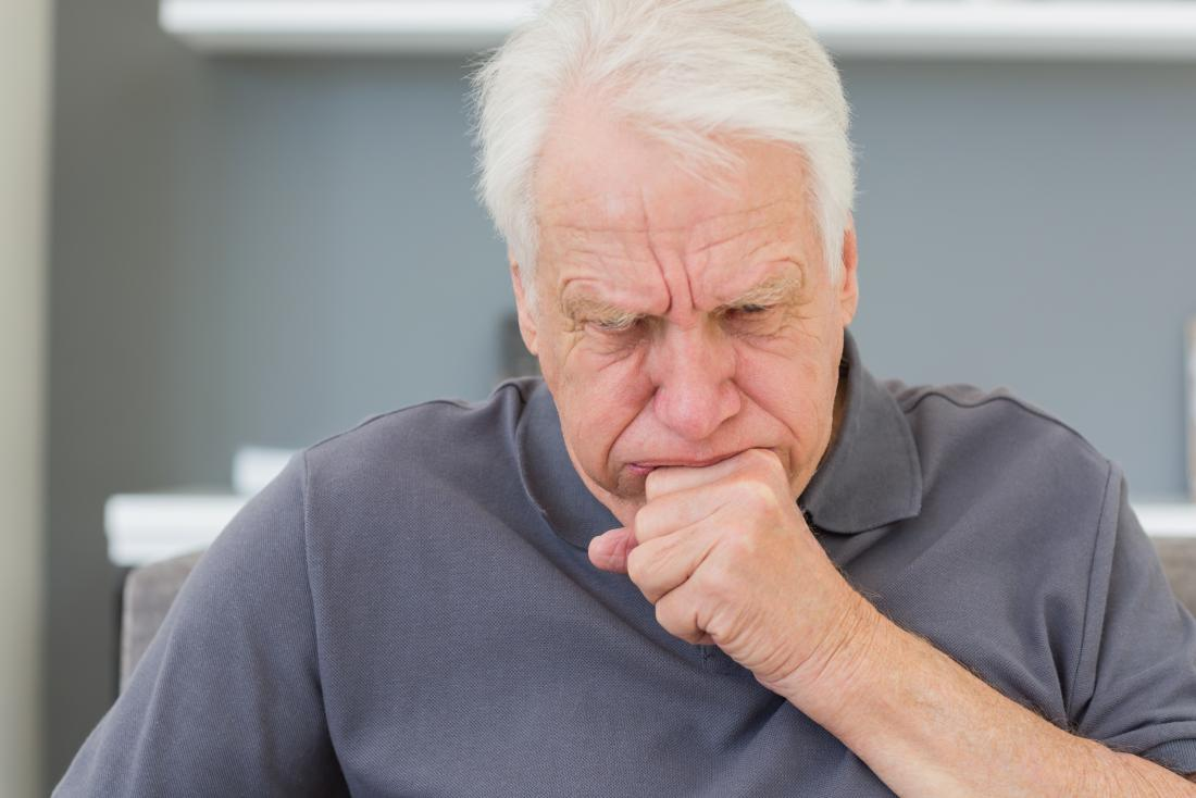 a mature man coughing because he has either Small cell or non-small cell lung cancer