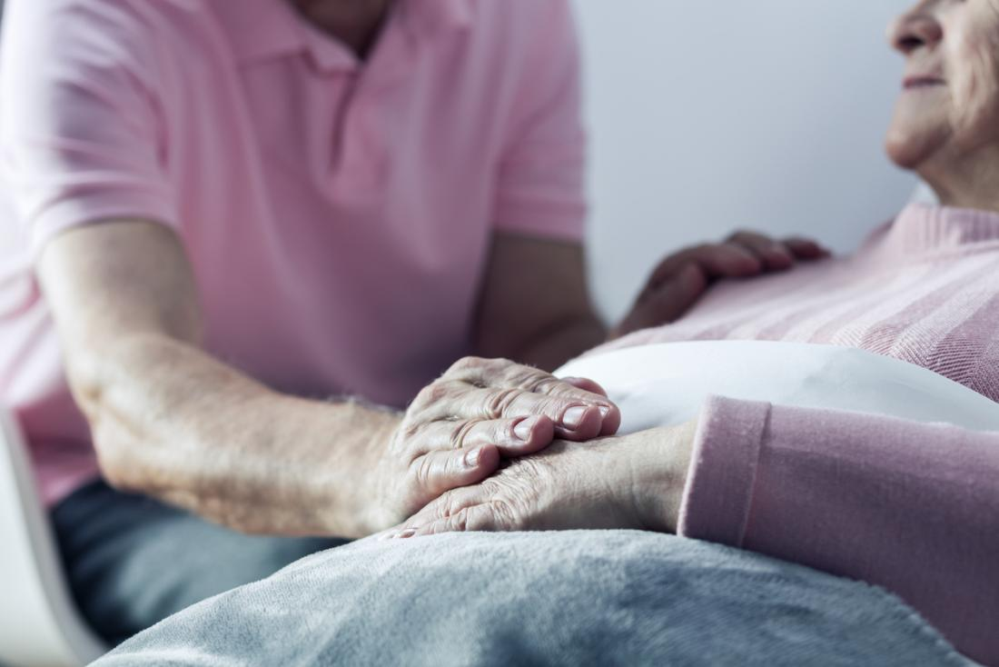 [closeup of caring hands in a hospital]