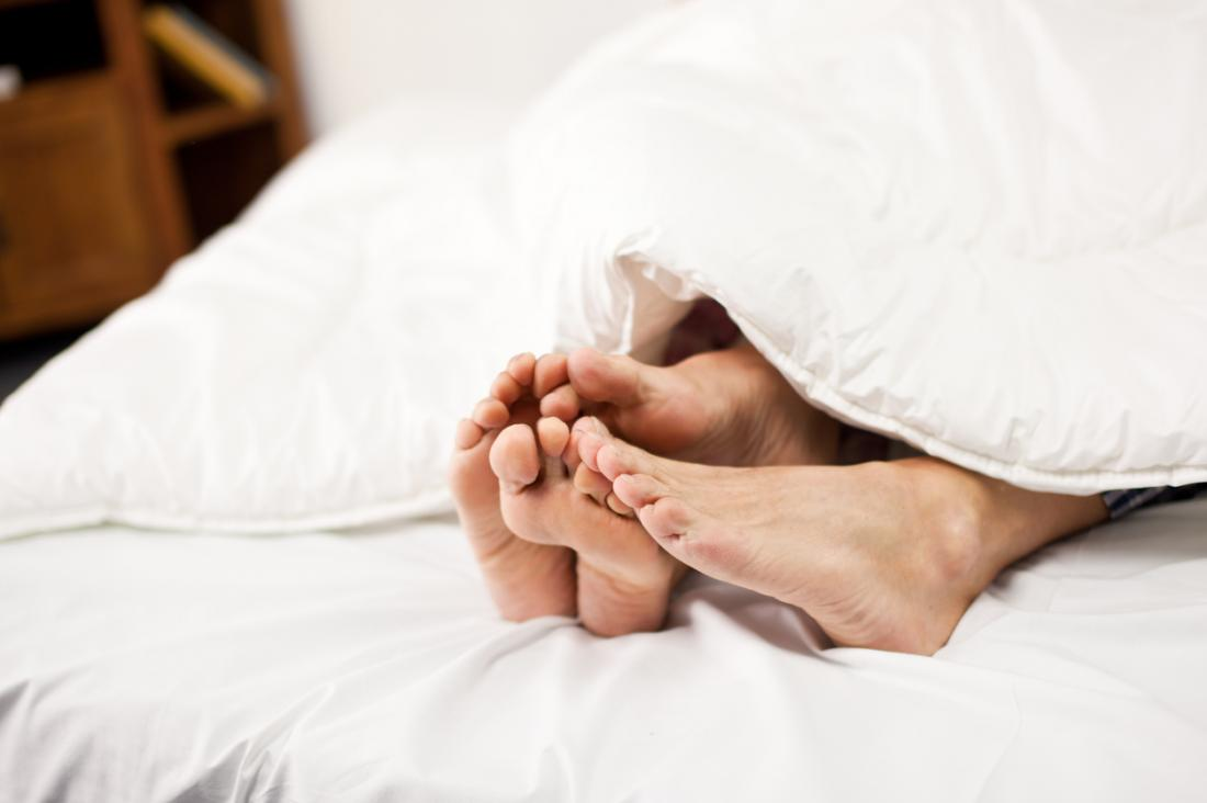 couples feet at end of bed