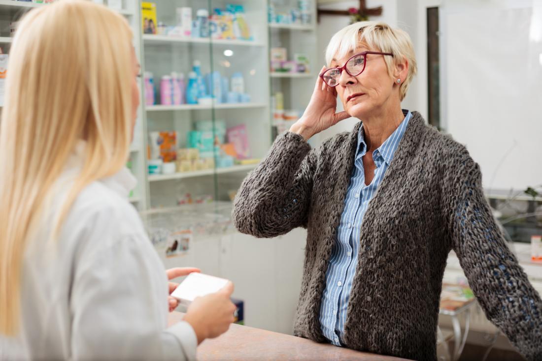 woman buys heart medication