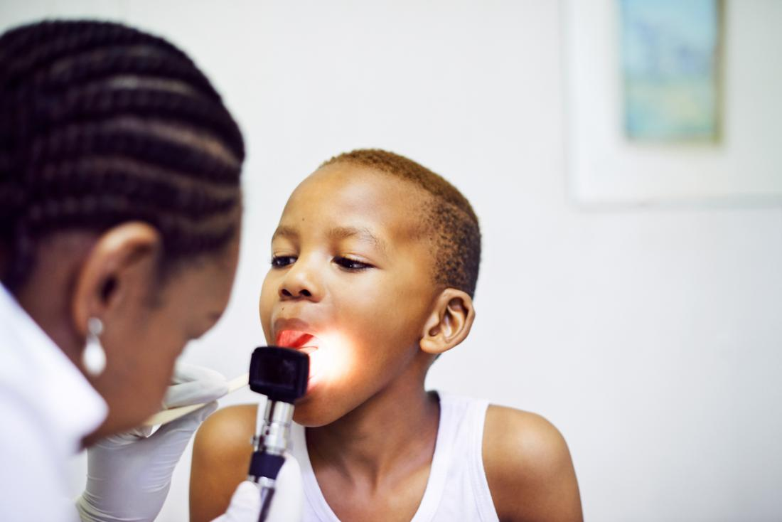 doctor examining the a childs throat