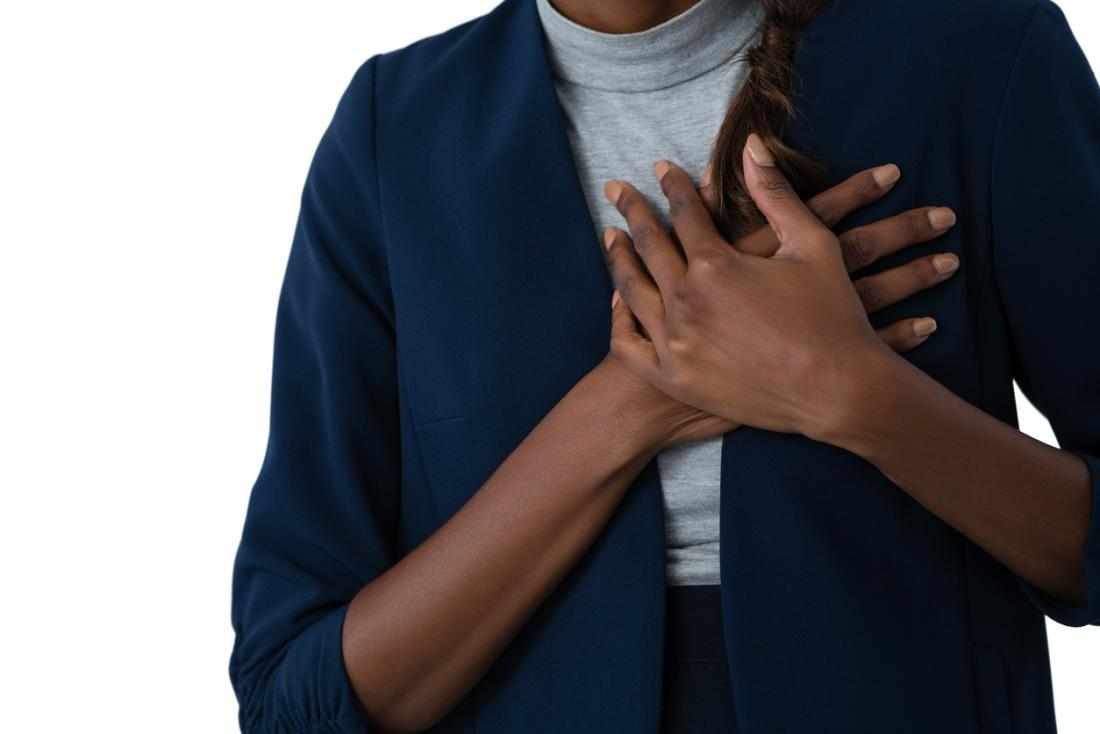 woman holding chest