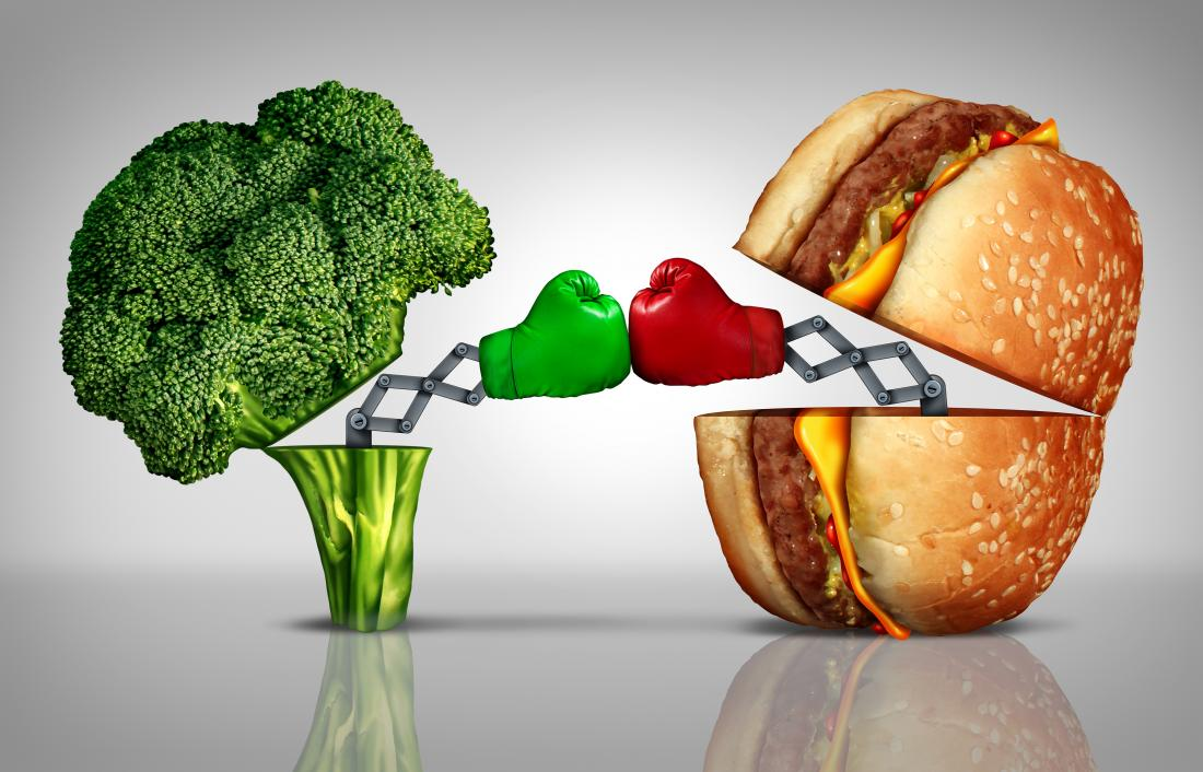 Broccoli fighting a burger