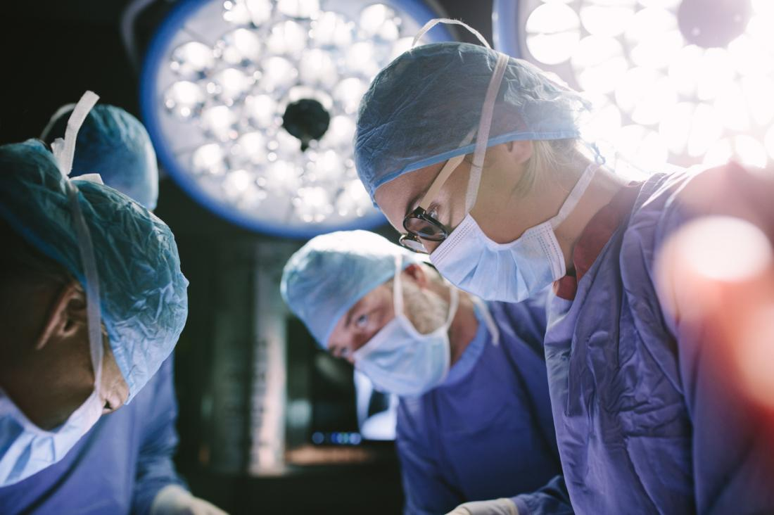 surgeons working on a patient