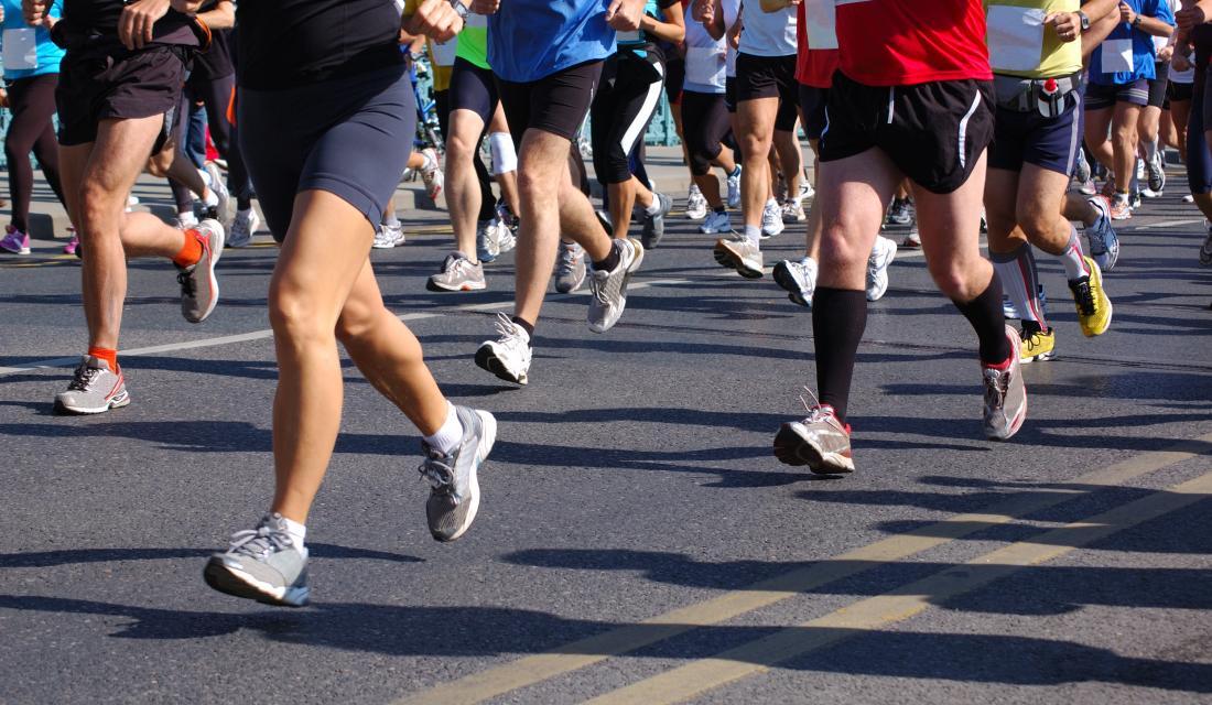 marathon runners viewed from waist down
