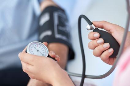 man having his blood pressure taken