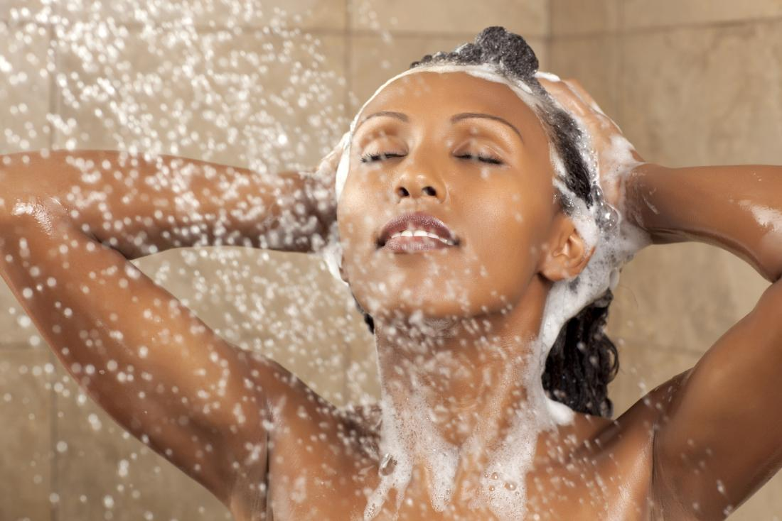 Woman using shampoo in the shower to help with eczema on the scalp