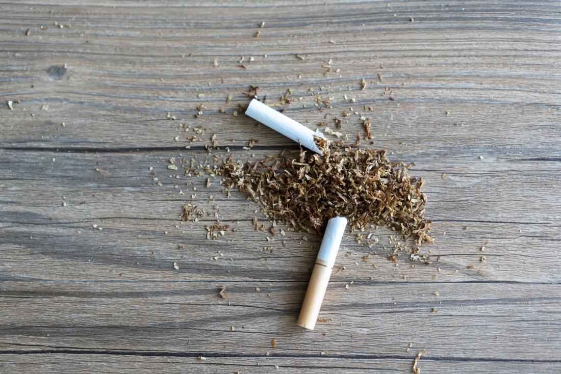 Quitting smoking represented by broken cigarette on table.