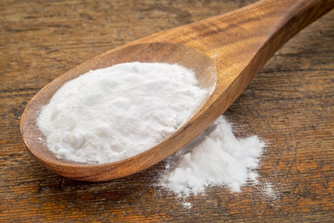 Baking soda on a spoon which may be used for acne