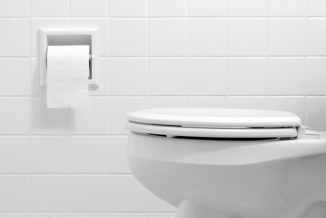 Toilet with toilet paper representing foamy urine.