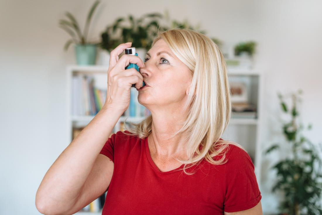 mature lady using an inhaler