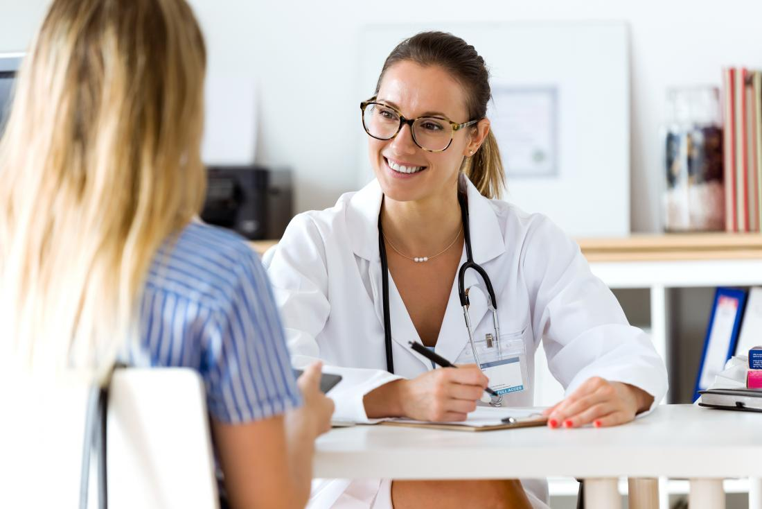 Female doctor speaking with female patient.