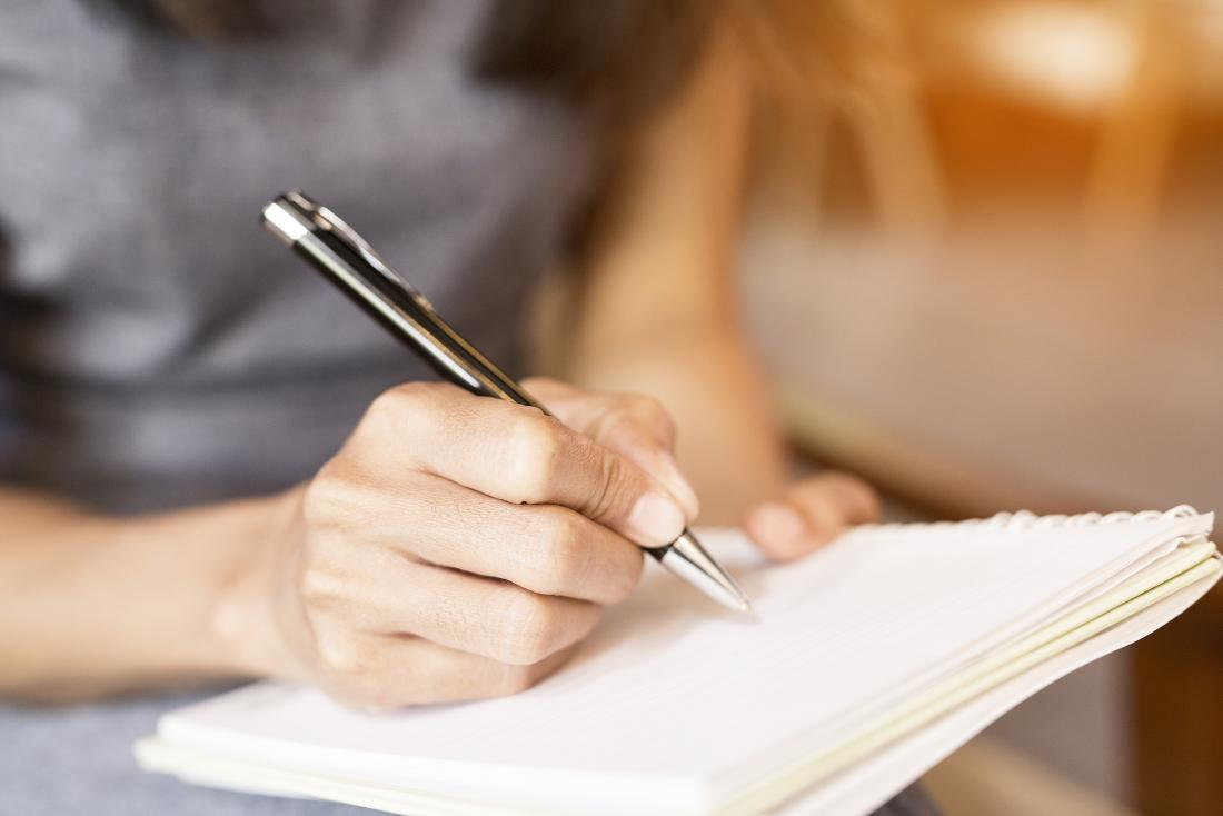 Person making notes in a journal