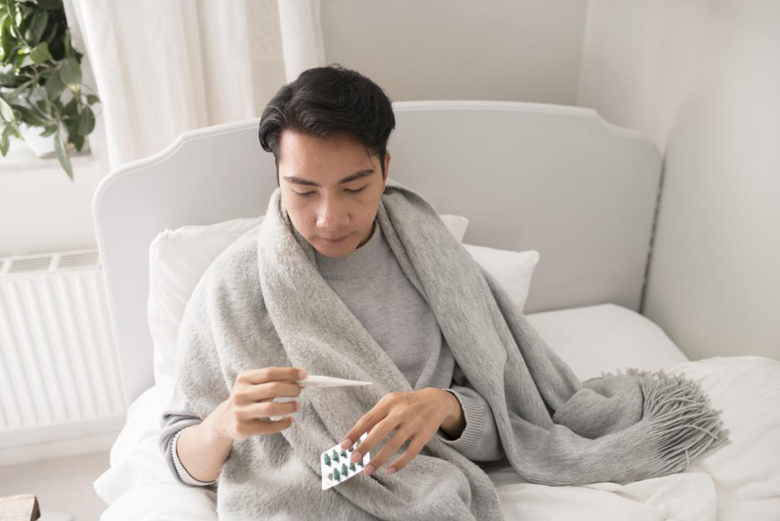 man with temperature feeling ill