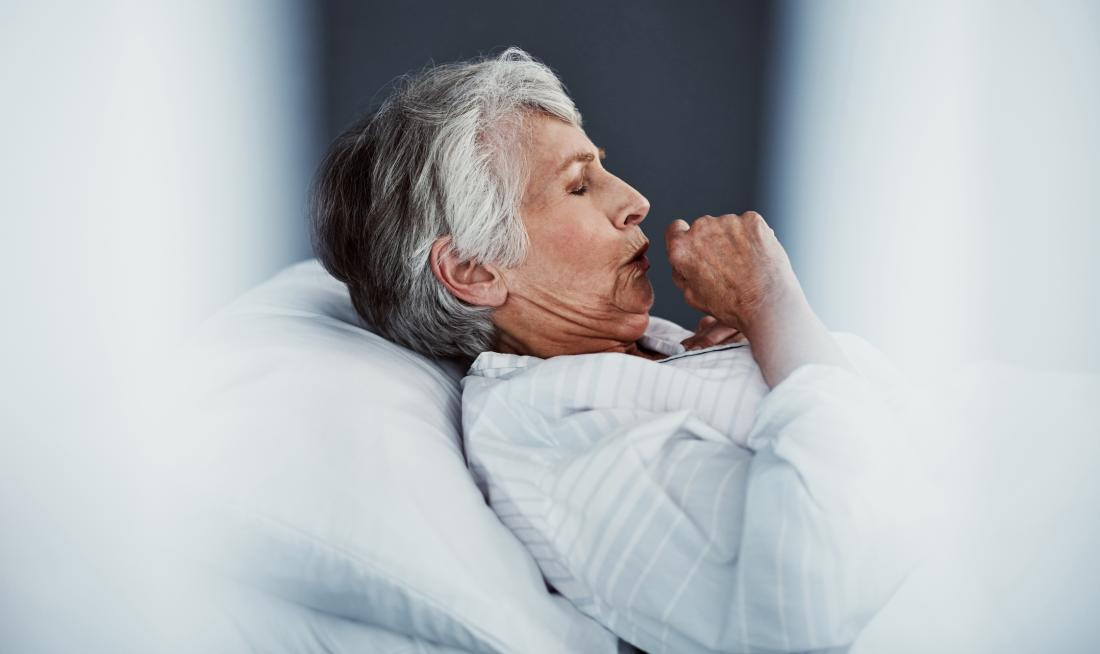 Senior with a cough in bed