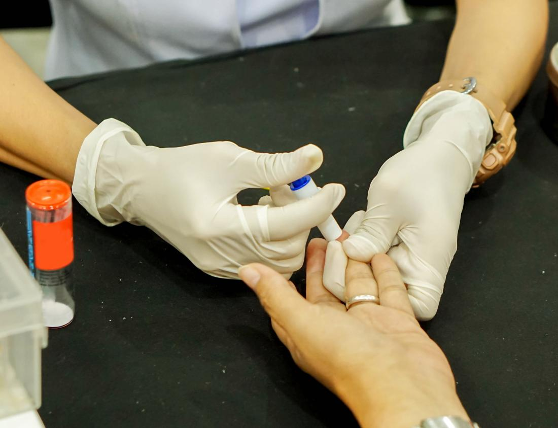 Doctor taking blood test for HIV test