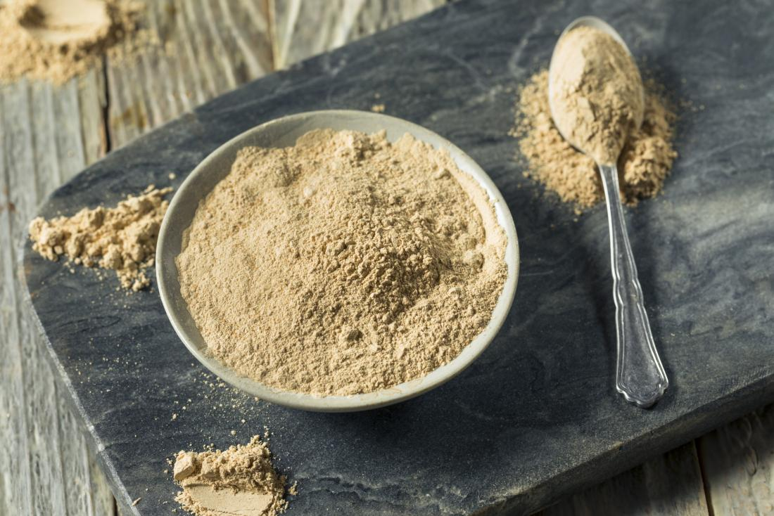 Maca powder in bowl on slate