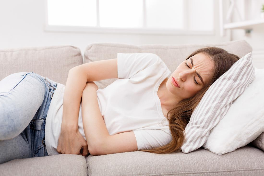 Woman holding her stomach due to a bowel obstruction