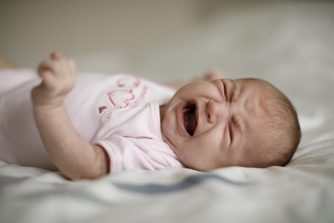 Baby crying in sleep: What's normal and how to soothe them