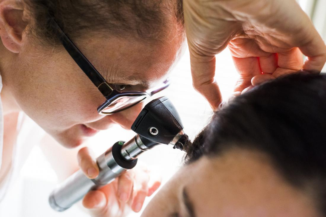 doctor using an otoscope