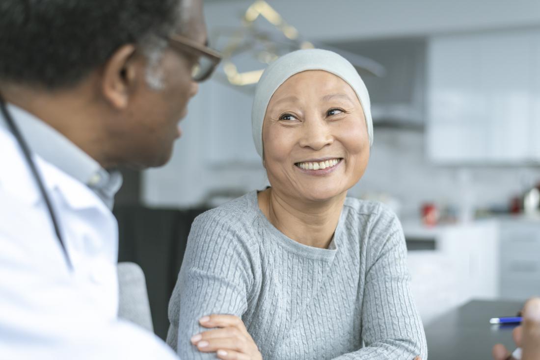 cancer survivor speaking to her doctor