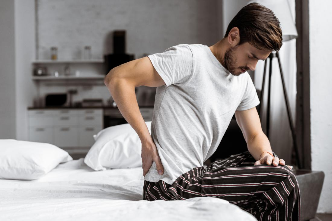 Lower back and testicle pain: Causes and when to see a doctor