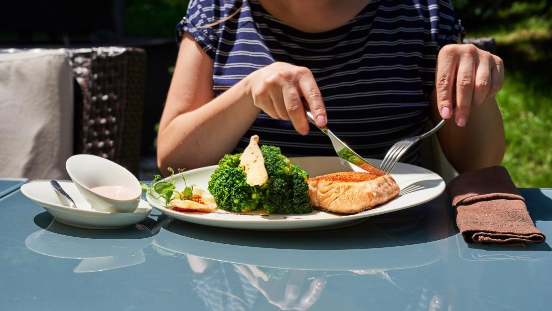 A woman eating fish