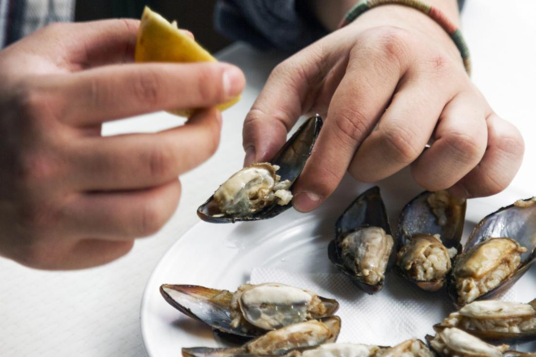 Shellfish allergy symptoms may include indigestion, vomiting, and stomach pain.