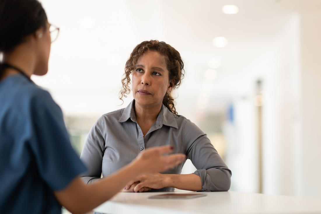 female patient listening to female doctor