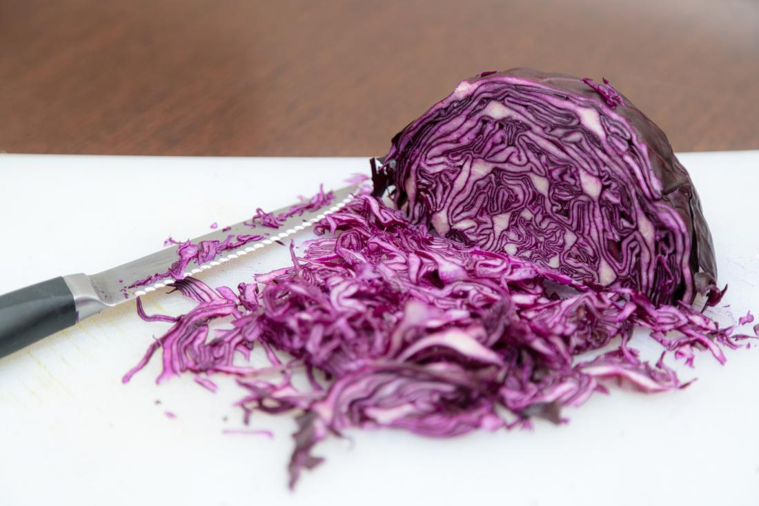 chopped red cabbage on a chopping board.