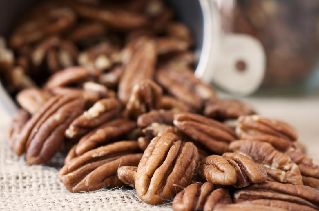 Pecan Halves Tumbling out of a Measuring Cup
