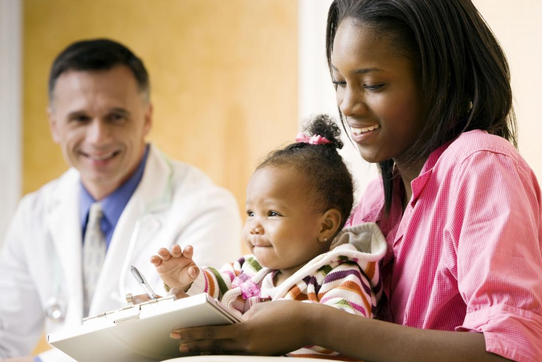 a baby and mother visiting a doctor.