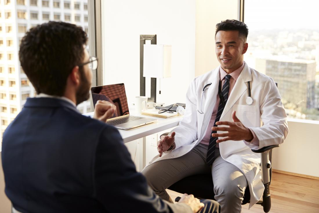 doctor smiling and explaining inflammation to patient