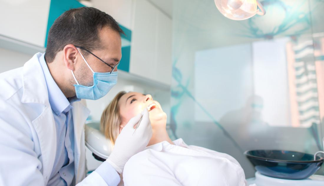 female patient at dentist