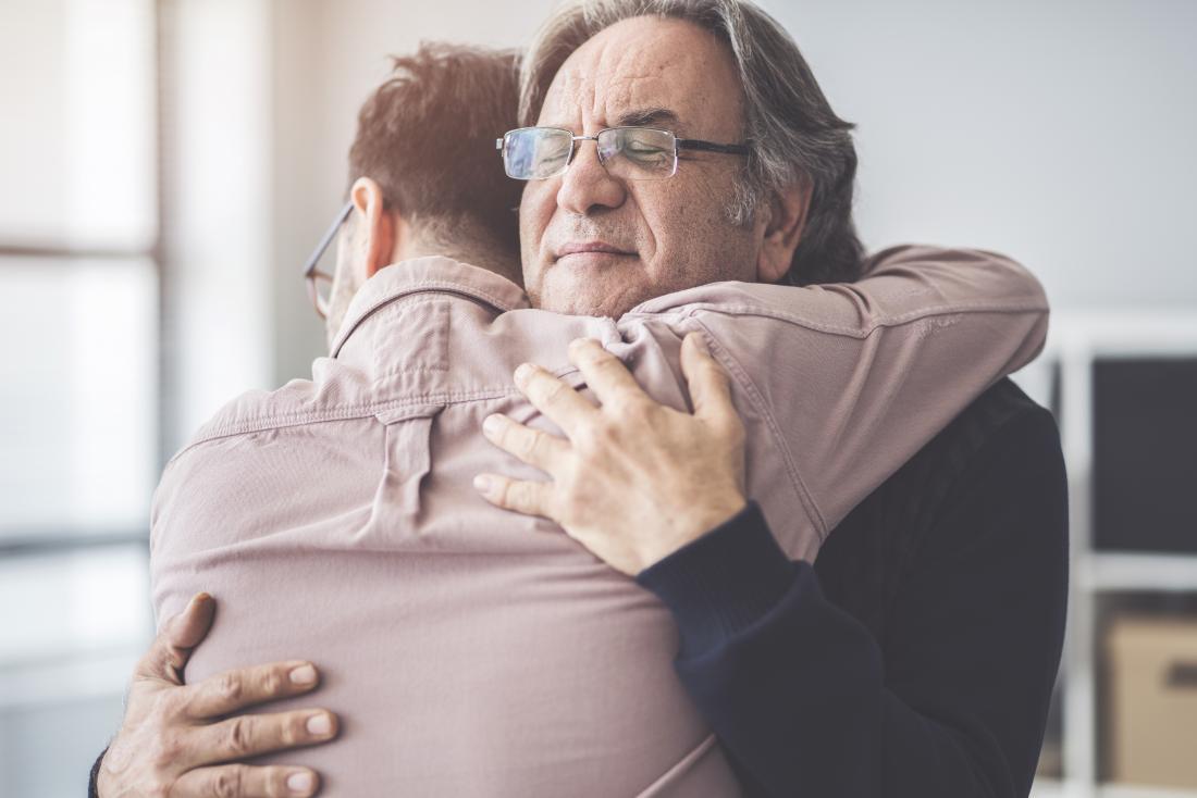 a father and son hug.
