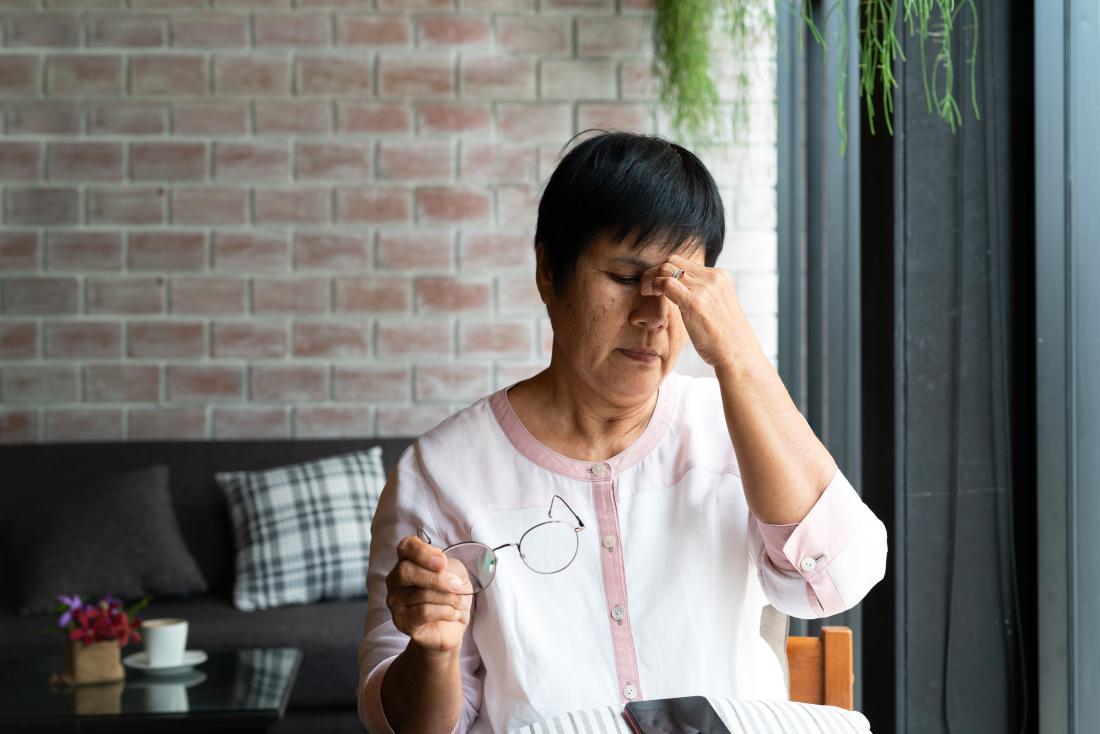 a woman with a headache that won't go away