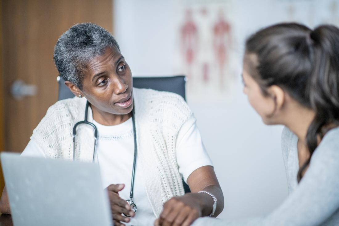 doctor explaining link between hepatitis c and cirrhosis to patient