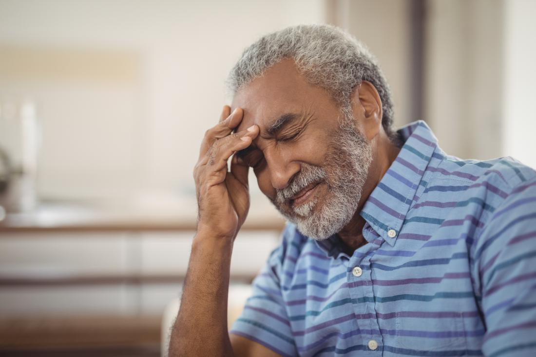 man with headache as part of stroke symptoms