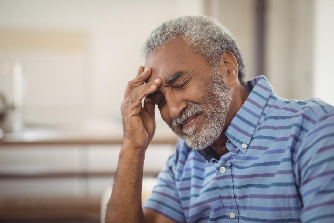 man with headache as part of stroke symptoms