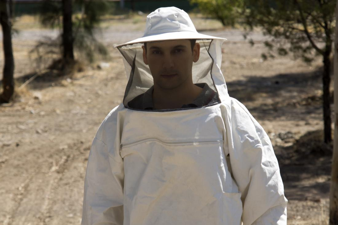a man wearing a beekeeper's bonnet.