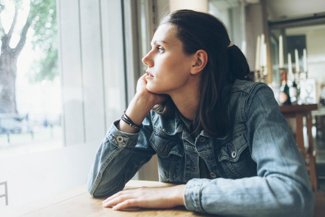 a woman looking out the window and wondering if PCOS is associated with diabetes