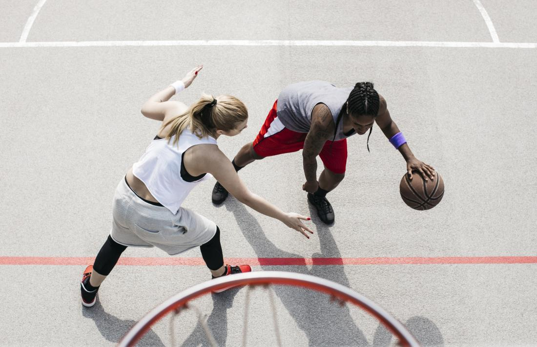 Woman playing basketball sports game for exercise and fitness