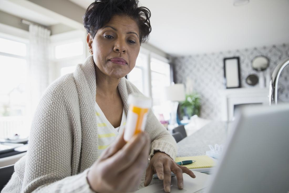 a lady holding a tube of pills wondering the pros and cons of concerta vs ritalin