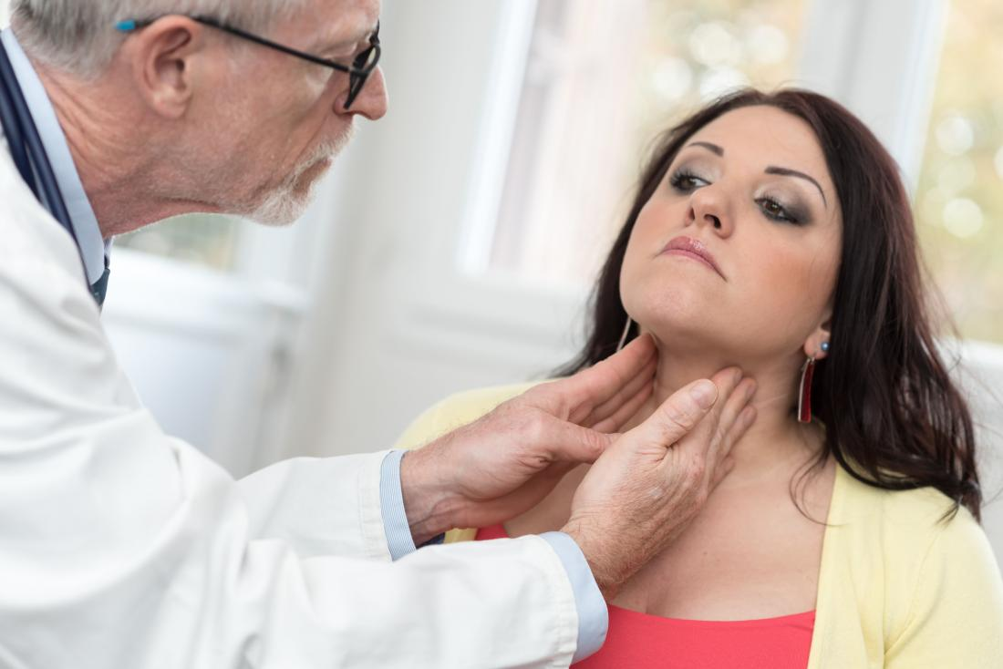 doctor examining womans neck
